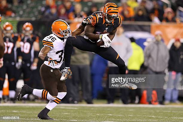 Mohamed Sanu of the Cincinnati Bengals catches a pass in front of K'Waun Williams of the Cleveland Browns during the fourth quarter at Paul Brown...