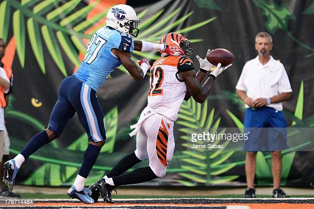 Mohamed Sanu of the Cincinnati Bengals catches a twoyard touchdown pass in the second quarter in front of Tommie Campbell of the Tennessee Titans at...