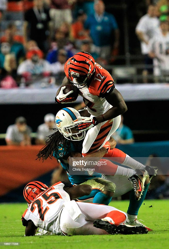 <a gi-track='captionPersonalityLinkClicked' href=/galleries/search?phrase=Mohamed+Sanu&family=editorial&specificpeople=6379095 ng-click='$event.stopPropagation()'>Mohamed Sanu</a> #12 of the Cincinnati Bengals is tackled by <a gi-track='captionPersonalityLinkClicked' href=/galleries/search?phrase=Philip+Wheeler&family=editorial&specificpeople=2253975 ng-click='$event.stopPropagation()'>Philip Wheeler</a> #52 of the Miami Dolphins at Sun Life Stadium on October 31, 2013 in Miami Gardens, Florida.