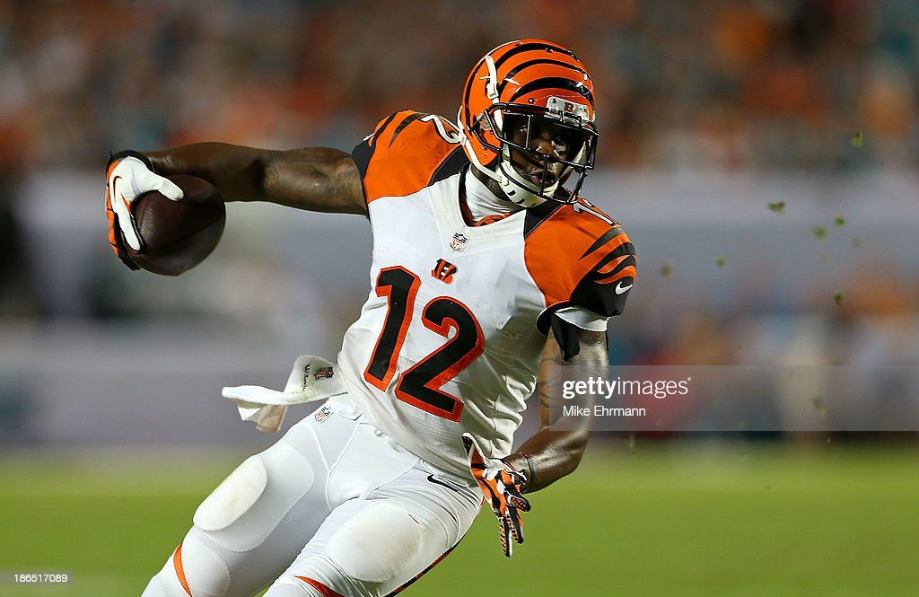 Mohamed Sanu #12 of the Cincinnati Bengals runs after a catch during a game against the Miami Dolphins at Sun Life Stadium on October 31, 2013 in Miami Gardens, Florida.