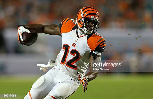 Mohamed Sanu of the Cincinnati Bengals runs after a catch during a game against the Miami Dolphins at Sun Life Stadium on October 31 2013 in Miami...