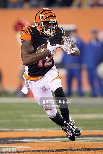 Mohamed Sanu of the Cincinnati Bengals runs with the ball after catching a pass during the third quarter of the game against the Denver Broncos at...