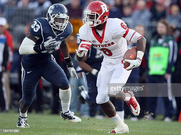 Mohamed Sanu of the Rutgers Scarlet Knights carries the ball as Yawin Smallwood of the Connecticut Huskies defends on November 26 2011 at Rentschler...