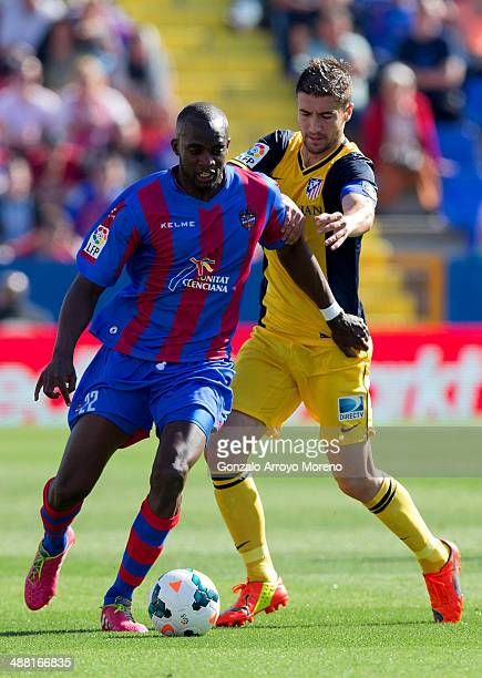 Mohamed Sissoko of Levante UD competes for the ball with Gabi Fernandez of Atletico de Madrid during the La Liga match between Levante UD and Club...