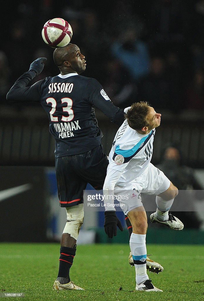 <a gi-track='captionPersonalityLinkClicked' href=/galleries/search?phrase=Mohamed+Sissoko&family=editorial&specificpeople=647096 ng-click='$event.stopPropagation()'>Mohamed Sissoko</a> of Paris Saint-Germain competes for the ball with <a gi-track='captionPersonalityLinkClicked' href=/galleries/search?phrase=Benoit+Pedretti&family=editorial&specificpeople=714997 ng-click='$event.stopPropagation()'>Benoit Pedretti</a> (R) of Lille during the Ligue1 match between Paris Saint-Germain FC and LOSC Lille Metropole on December 18, 2011 in Paris, France.