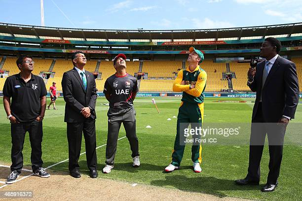 Mohamed Tauqir of the UAE and AB de Villiers of South Africa during the coin toss prior to the start of the 2015 ICC Cricket World Cup match between...