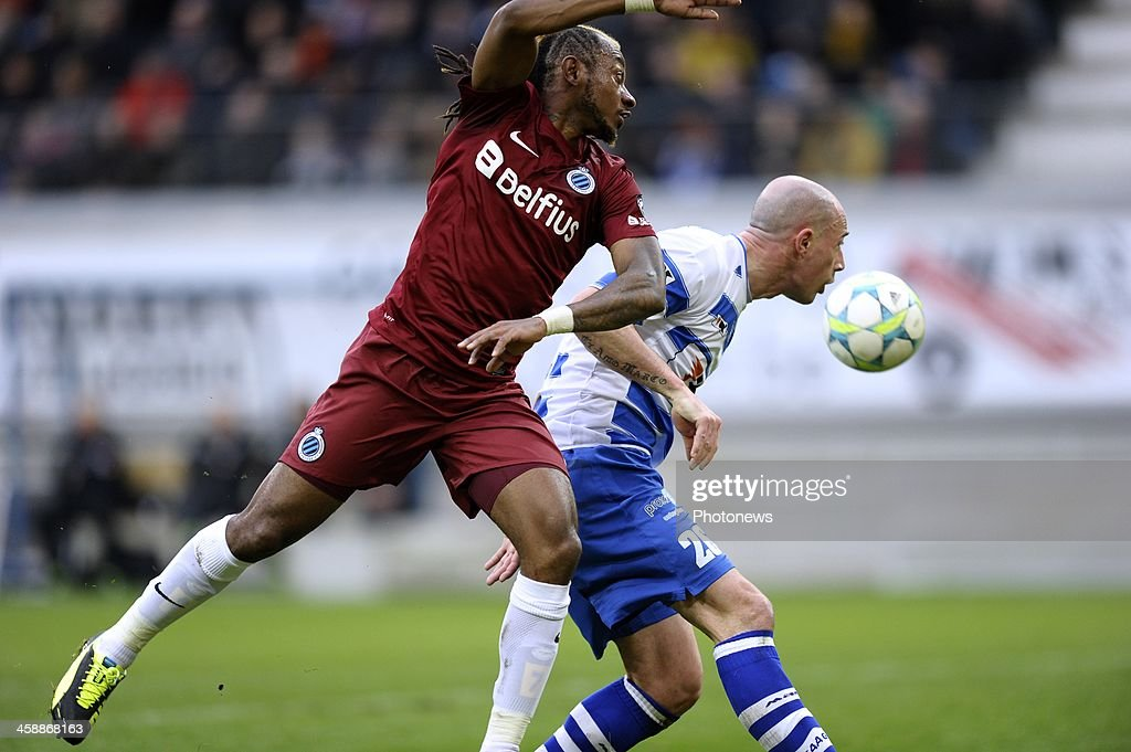 Mohamed Tchite of Club Brugge battles for the ball with Christophe Lepoint of KAA Gent during the Jupiler League match between KAA Gent and Club Brugge on December 22, 2013 at the Ghelamco arena in Gent, Belgium.