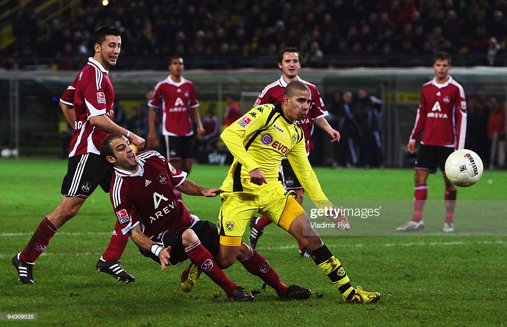 Mohamed Zidan of Dortmund is defended by Javier Pinola of Nuernberg during the Bundesliga match between Borussia Dortmund and 1 FC Nuernberg at...