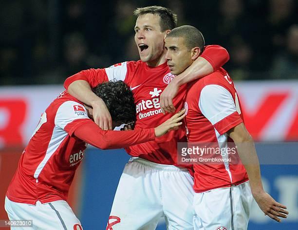 Mohamed Zidan of Mainz celebrates with teammates Radoslav Zabavnik and Nicolai Mueller after scoring his team's first goal during the Bundesliga...