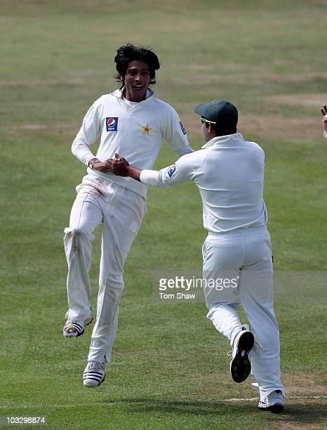 Mohammad Aamer of Pakistan celebrates taking the wicket of Alastair Cook of England during day four of the 2nd npower Test Match between England and...