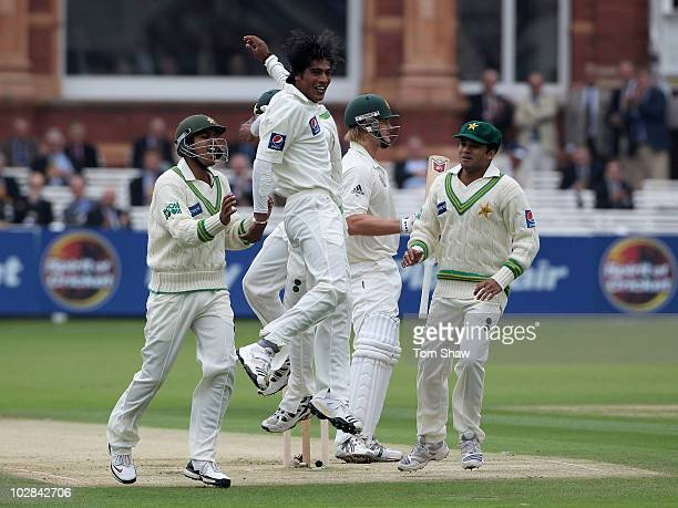 Mohammad Aamer of Pakistan celebrates taking the wicket of Shane Watson of Australia bowled out during the 1st Test match between Australia and...