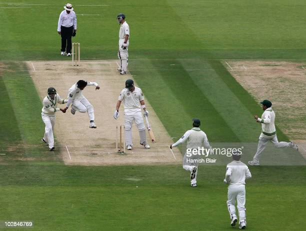 Mohammad Aamer of Pakistan celebrates the wicket of Shane Watson of Australia during day one of the First Test between Pakistan and Australia at...