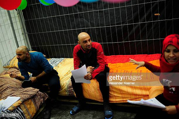 Mohammad Abdulhalim and relatives from Bagdad Iraq practice their German inside a shelter where they are living while their asylum applications are...