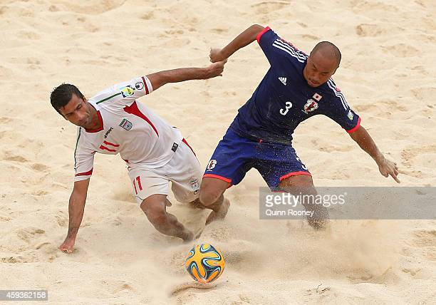 Mohammad Ahmadzadeh of Iran and Hirofumi Oda of Japan compete for the ball during the Men's Beach Soccer gold medal match between Iran and Japan...