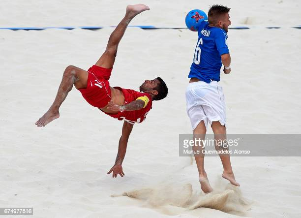 Mohammad Ahmadzadeh of Iran attempts a scissor kick shot on goal in front Simone Marinai of Italy during the FIFA Beach Soccer World Cup Bahamas 2017...