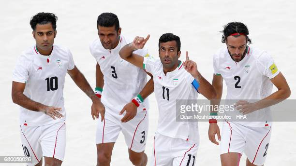 Mohammad Ahmadzadeh of Iran celebrates scoring his teams first goal of the game with team mates Moslem Mesigar Hassan Abdollahi and Amir Akbari...