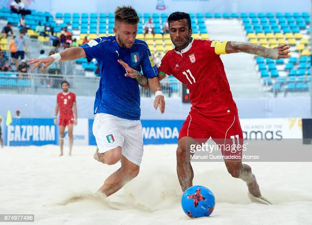 Mohammad Ahmadzadeh of Iran competes for the ball with Simone Marinai of Italy during the FIFA Beach Soccer World Cup Bahamas 2017 group B match...