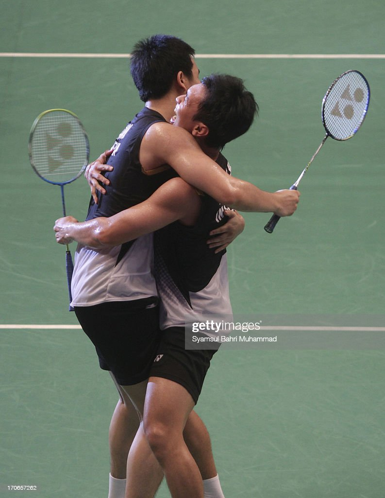 Mohammad Ahsan and <a gi-track='captionPersonalityLinkClicked' href=/galleries/search?phrase=Hendra+Setiawan&family=editorial&specificpeople=2237241 ng-click='$event.stopPropagation()'>Hendra Setiawan</a> of Indonesia celebrate after winning the Badminton Indonesia Open Super Series 2013 men's doubles final match against Ko Sung Hyun and Lee Yong Dae of South Korea on June 16, 2013 in Jakarta, Indonesia.
