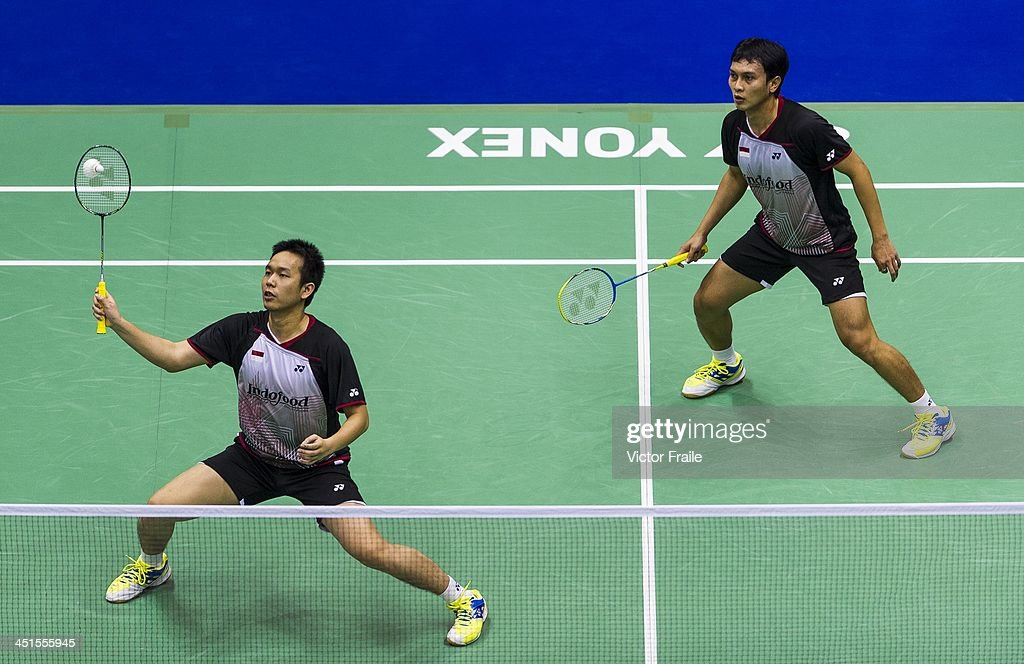 Mohammad Ahsan and <a gi-track='captionPersonalityLinkClicked' href=/galleries/search?phrase=Hendra+Setiawan&family=editorial&specificpeople=2237241 ng-click='$event.stopPropagation()'>Hendra Setiawan</a> of Indonesia in action against Lee Yong Dae and Yoo Yeon Seong of South Korea during their men doubles semi-final match during the Yonex Hong Kong Open on November 23, 2013 in Hong Kong, Hong Kong.