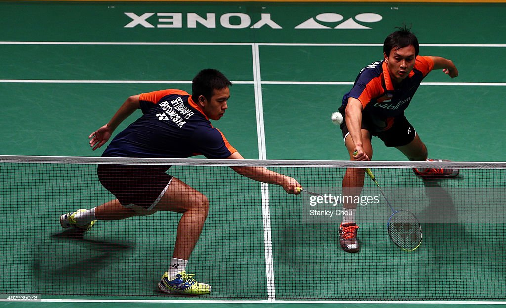 Mohammad Ahsan and <a gi-track='captionPersonalityLinkClicked' href=/galleries/search?phrase=Hendra+Setiawan&family=editorial&specificpeople=2237241 ng-click='$event.stopPropagation()'>Hendra Setiawan</a> of Indonesia in action during day three of the Men's Doubles of the Malaysia Badminton Open on January 16, 2014 in Kuala Lumpur, Malaysia.
