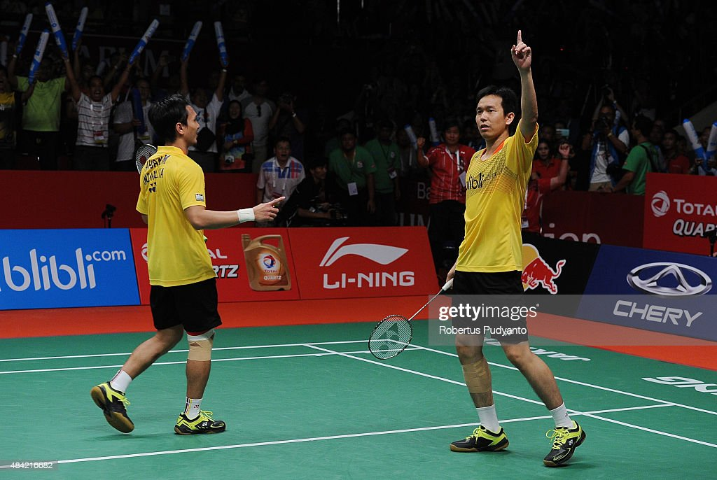 Mohammad Ahsan and <a gi-track='captionPersonalityLinkClicked' href=/galleries/search?phrase=Hendra+Setiawan&family=editorial&specificpeople=2237241 ng-click='$event.stopPropagation()'>Hendra Setiawan</a> of Indonesia react after defating Liu Xiaolong and Qiu Zihan of China in the men doubles final match of the 2015 Total BWF World Championship at Istora Senayan on August 16, 2015 in Jakarta, Indonesia.