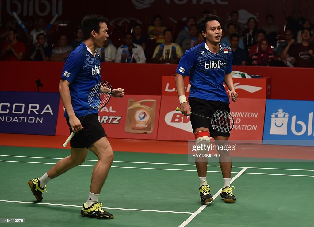 Mohammad Ahsan (R) and <a gi-track='captionPersonalityLinkClicked' href=/galleries/search?phrase=Hendra+Setiawan&family=editorial&specificpeople=2237241 ng-click='$event.stopPropagation()'>Hendra Setiawan</a> of Indonesia react against Lee Yong-Dae and Yoo Yeon-Seong of South Korea during their semi-final men's doubles match of the 2015 World Championships badminton tournament in Jakarta on August 15, 2015. AFP PHOTO / Bay ISMOYO