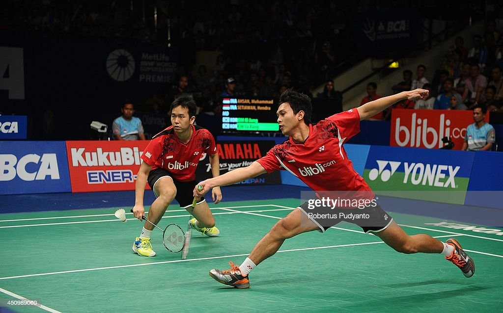Mohammad Ahsan and <a gi-track='captionPersonalityLinkClicked' href=/galleries/search?phrase=Hendra+Setiawan&family=editorial&specificpeople=2237241 ng-click='$event.stopPropagation()'>Hendra Setiawan</a> of Indonesia return a shot against Kim Ki Jung and Kim Sa Rang of Korea during the semifinal BCA Indonesia Open 2014 MetLife BWF World Super Series Premier at Istora Gelora Bung Karno Stadium on June 21, 2014 in Jakarta, Indonesia.