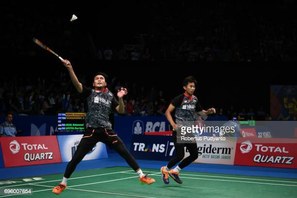 Mohammad Ahsan and Rian Agung Saputro of Indonesia compete against Kittinupong Kedren and Dechapol Puavaranukroh of Thailand during Mens Double Round...