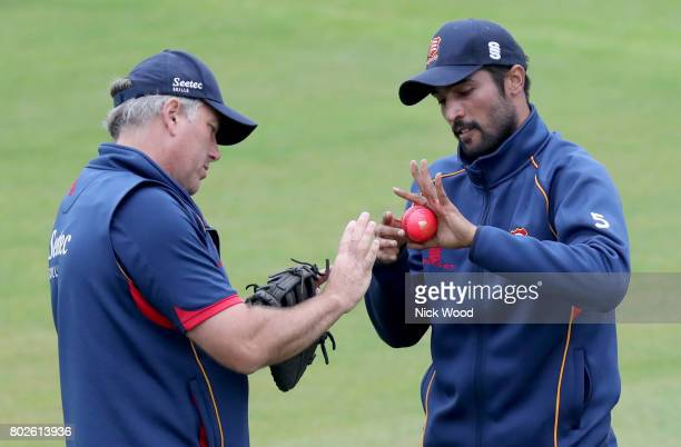Mohammad Amir and Chris Silverwood of Essex discuss ball holding prior to the Essex v Middlesex Specsavers County Championship Division One cricket...