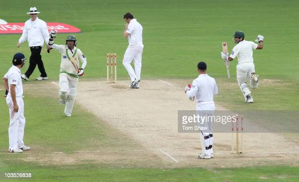 Mohammad Amir and Umar Akmal of Pakistan celebrate victory during day four of the npower 3rd Test Match between England and Pakistan at The Brit...