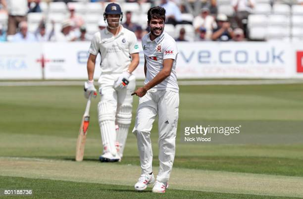Mohammad Amir of Essex smiles having removed Nick Gubbins during the Essex v Middlesex Specsavers County Championship Division One cricket match at...