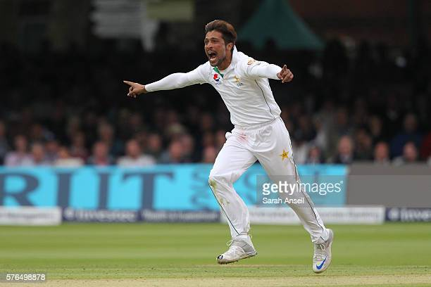 Mohammad Amir of Pakistan celebrates after dismissing the England captain Alastair Cook during day 2 of the First Investec Test match between England...