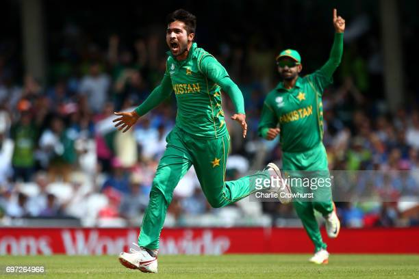 Mohammad Amir of Pakistan celebrates after taking the wicket of India's Shikhar Dhawan during the ICC Champions Trophy Final match between India and...