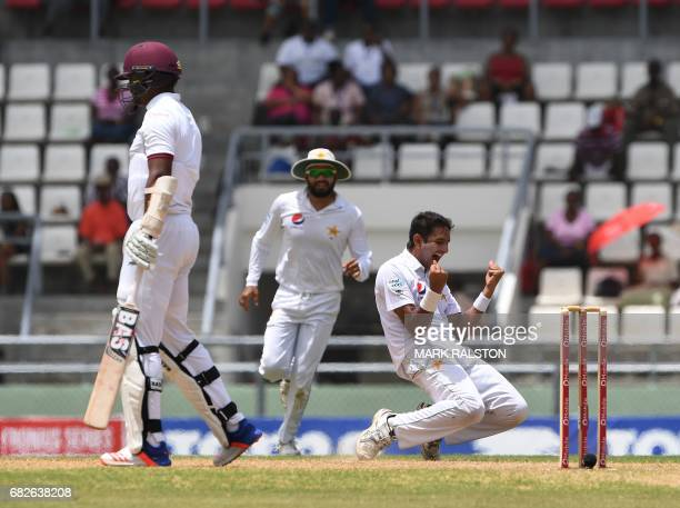 Mohammad Amir of Pakistan celebrates after taking the wicket of West Indies batsman Shannon Gabriel for 0 caught by Babar Azam during the fourth days...