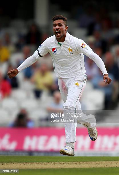 Mohammad Amir of Pakistan celebrates getting the wicket of Jonny Bairstow of England during day one of the 4th Investec Test between England and...