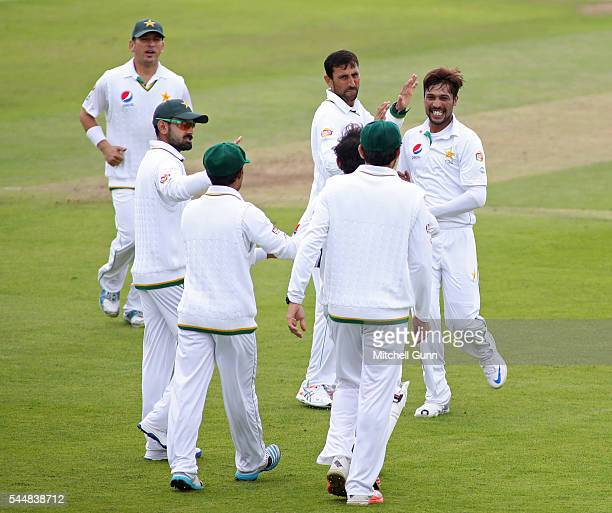 Mohammad Amir of Pakistan celebrates taking the wicket of Marcus Trescothick of Somerset during day two of the tour match between Somerset and...