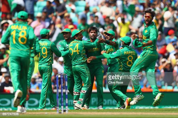 Mohammad Amir of Pakistan celebrates the wicket of Virat Kohli of India during the ICC Champions trophy cricket match between India and Pakistan at...