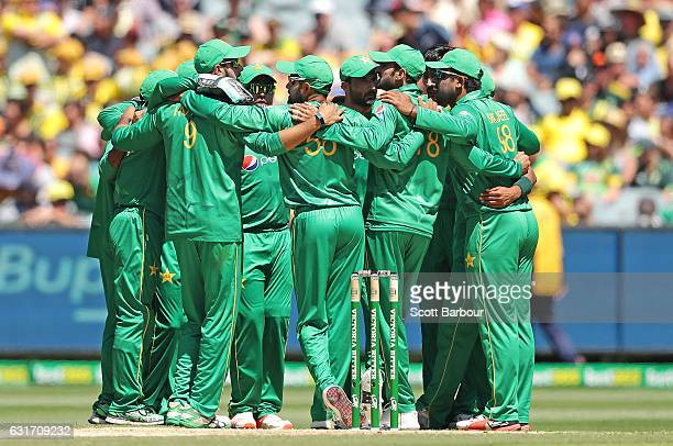 Mohammad Amir of Pakistan celebrates with his teammates in a huddle after dismissing Mitchell Marsh of Australia during game two of the One Day...