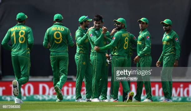 Mohammad Amir of Pakistan celebrates with teammates after dismissing Shikhar Dhawan of India during the ICC Champions Trophy Final between India and...