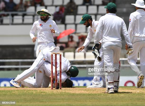Mohammad Amir of Pakistan celebrates with teammates after taking the wicket of West Indies batsman Shannon Gabriel for 0 caught by Babar Azam during...
