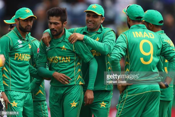Mohammad Amir of Pakistan is congratulated by Fakhar Zaman after bowling Angelo Mathews of Sri Lanka during the ICC Champions Trophy match between...