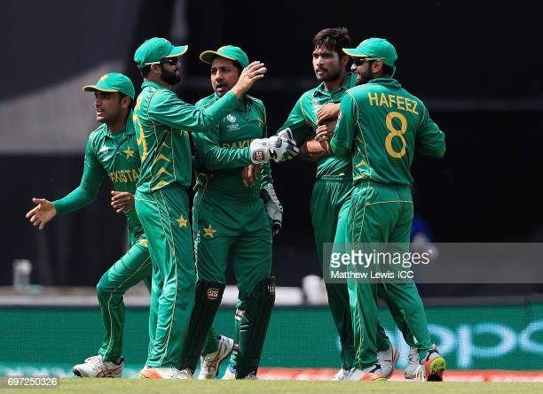 Mohammad Amir of Pakistan is congratulated on the wicket of Virat Kohli of India after he was caught by Shadab Khan during the ICC Champions Trophy...