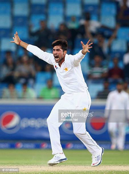 Mohammad Amir of Pakistan reacts during Day Five of the First Test between Pakistan and West Indies at Dubai International Cricket Ground on October...