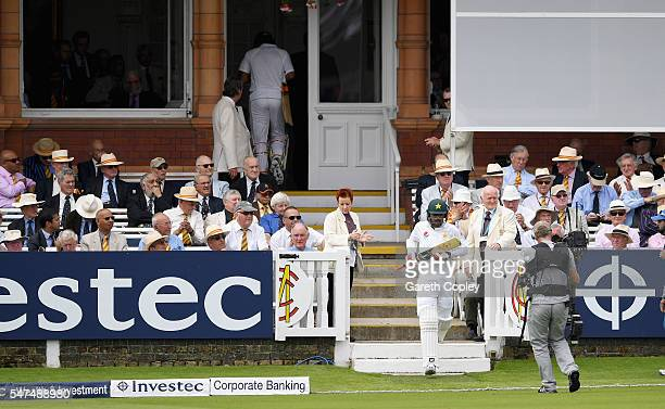 Mohammad Amir of Pakistan walks out to bat during day two of the 1st Investec Test between England and Pakistan at Lord's Cricket Ground on July 15...