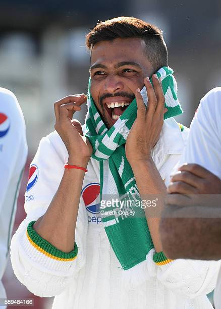 Mohammad Amir of Pakistan wears a Pakistan scarf after winning the 4th Investec Test between England and Pakistan at The Kia Oval on August 14 2016...