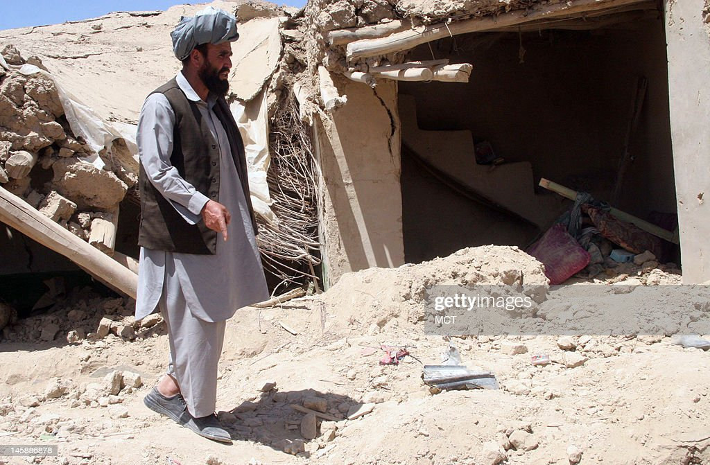Mohammad Anwar Kochi, a tribal elder in the village where locals say 18 people were killed a Wednesday NATO airstrike, is pictured at the site of the airstrike Thursday June 7, 2012, in the village of Sajawand, in Logar province, Afghanistan.