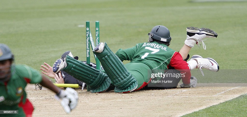 Mohammad Ashraful of Bangladdesh crashes into Martin Guptill of New Zealand during the third One Day International match between the New Zealand...