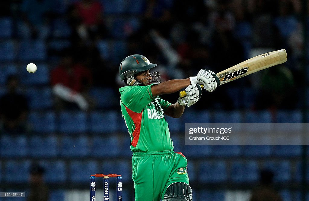 <a gi-track='captionPersonalityLinkClicked' href=/galleries/search?phrase=Mohammad+Ashraful&family=editorial&specificpeople=224689 ng-click='$event.stopPropagation()'>Mohammad Ashraful</a> of Bangladesh bats during the ICC World T20 Group D match between New Zealand and Bangladesh at Pallekele Cricket Stadium on September 21, 2012 in Kandy, Sri Lanka.