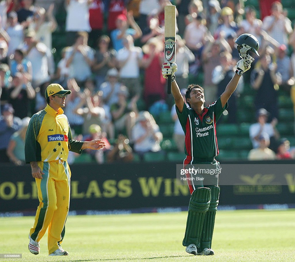 Mohammad Ashraful of Bangladesh celebrates his century with Ricky Ponting of Australia looking on during the NatWest Series One Day International...