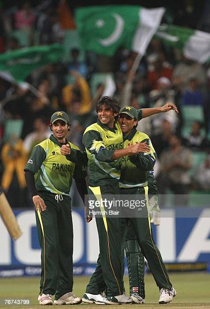 Mohammad Asif of Pakistan celebrates with team mates after taking the wicket of Dinesh Karthik of India during the ICC Twenty20 Cricket World...